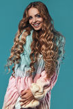 Portrait of beautiful smiling blond woman with long hair Stock Photo