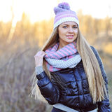 Portrait of beautiful smiling blonde woman in down jacket outdoo Stock Photo