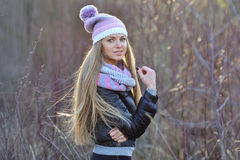 Portrait of beautiful smiling blonde woman in down jacket outdoo Royalty Free Stock Photography