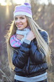 Portrait of beautiful smiling blonde woman in down jacket outdoo Stock Photography