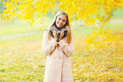 Portrait beautiful smiling blonde woman in warm sunny autumn Royalty Free Stock Photo