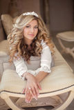 Portrait of beautiful smiling bride with long curly hair posing Stock Photos