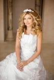 Portrait of a beautiful smiling bride in white wedding dress. Yo Royalty Free Stock Photo