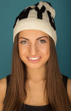 Portrait of beautiful smiling brown-haired woman in winter hat a Stock Photo