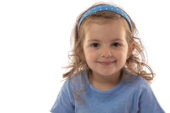 Portrait of a beautiful smiling child on a white background.  Stock Image