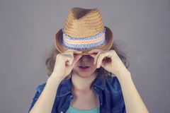 Portrait of beautiful curly hair teens girl with straw hat royalty free stock photo