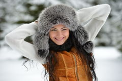 Portrait of beautiful smiling female in luxurious fur head cloth Royalty Free Stock Photos