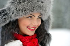 Portrait of beautiful smiling female in luxurious fur head cloth Stock Image