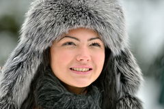 Portrait of beautiful smiling female in luxurious fur head cloth Royalty Free Stock Image