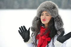 Portrait of beautiful smiling female in luxurious fur head cloth Royalty Free Stock Photography