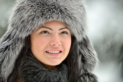 Portrait of beautiful smiling female in luxurious fur head cloth Royalty Free Stock Photo