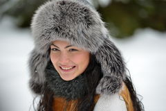 Portrait of beautiful smiling female in luxurious fur head cloth Royalty Free Stock Images