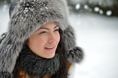 Portrait of beautiful smiling female in luxurious fur head cloth Stock Images