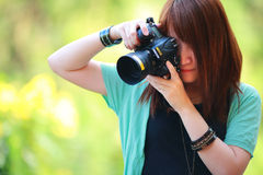 Portrait of beautiful smiling girl,with digital camera in her hands Royalty Free Stock Photos