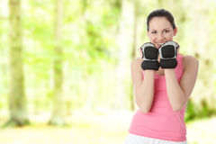 Portrait of beautiful smiling girl with dumbbells Royalty Free Stock Photo