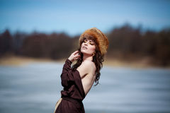 Portrait of a beautiful smiling girl in a fur hat Royalty Free Stock Photo
