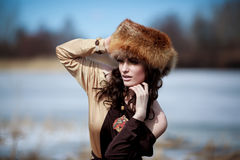 Portrait of a beautiful smiling girl in a fur hat Stock Images