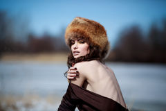 Portrait of a beautiful smiling girl in a fur hat Royalty Free Stock Photos
