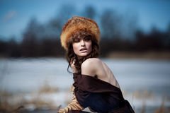 Portrait of a beautiful smiling girl in a fur hat Royalty Free Stock Images