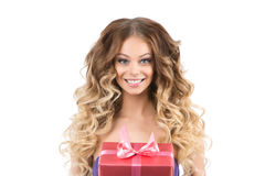 Portrait of beautiful smiling girl with gifts. On white background. A girl with beautiful curly hair and makeup Royalty Free Stock Photos
