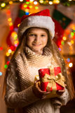 Portrait of beautiful smiling girl holding gift box at Christmas Royalty Free Stock Photos