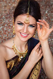 Portrait of beautiful smiling girl in indian sari. Beautiful smiling girl with oriental make-up and indian sari Royalty Free Stock Photos