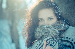 Portrait of a beautiful smiling girl near the tree in winter Royalty Free Stock Photography