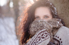 Portrait of a beautiful smiling girl near the tree in winter Royalty Free Stock Photo