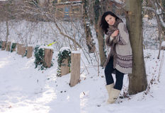 Portrait of a beautiful smiling girl near the tree in winter Royalty Free Stock Photos