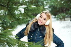 Portrait of beautiful smiling girl in snowy pinewood Stock Image