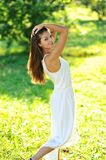 Portrait of beautiful smiling girl in a summer park. Portrait of beautiful smiling girl in a summer green park Stock Images