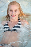 Portrait of beautiful smiling girl in a swimming pool Royalty Free Stock Photos