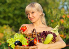 Portrait of beautiful smiling girl with vegetables and herbs Royalty Free Stock Images