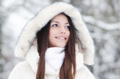 Portrait of the beautiful smiling girl in winter landscape Royalty Free Stock Photography