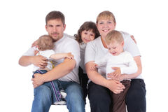Portrait of beautiful smiling happy family of five. Isolated over a white background royalty free stock photo