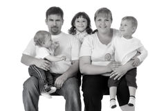 Portrait of beautiful smiling happy family of five. Isolated over a white background stock photo