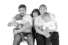 Portrait of beautiful smiling happy family of five. Isolated over a white background Royalty Free Stock Images