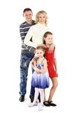 Portrait of beautiful smiling happy family of fou Stock Photos