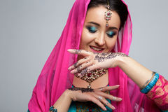 Portrait of beautiful smiling indian girl. Young indian woman model with traditional jewelry set Stock Photography