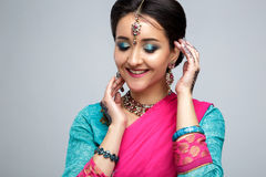 Portrait of beautiful smiling indian girl. Young indian woman model with traditional jewelry set Royalty Free Stock Photo