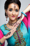 Portrait of beautiful smiling indian girl. Young indian woman model with traditional jewelry set Stock Images