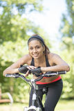 Portrait of beautiful smiling latin athletic woman with bike, ou Royalty Free Stock Photography