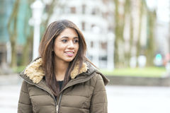 Portrait of beautiful smiling latin woman in the street. Royalty Free Stock Images