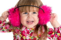 Portrait of a beautiful smiling little girl in fluffy headphones. On a white background Royalty Free Stock Photos