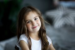 Portrait of a beautiful smiling little girl. In the studio Royalty Free Stock Image