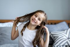 Portrait of a beautiful smiling little girl. In the studio Stock Photography