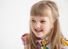 Portrait of a beautiful smiling little girl. On white background Royalty Free Stock Photography