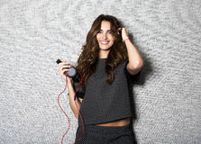 Portrait of beautiful smiling long haired DJ woman Royalty Free Stock Photo