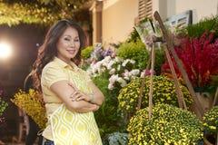 Positive flower shop owner stock image
