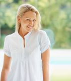 Portrait of a beautiful smiling middle aged female Stock Image